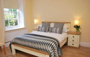 A bed or beds in a room at Rectory Hall