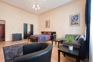 Ein Sitzbereich in der Unterkunft Kinizsi Apartment