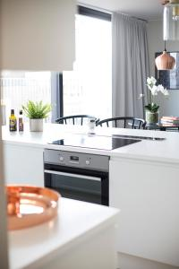 A kitchen or kitchenette at Frogner House Apartments - Huitfeldtsgate 19