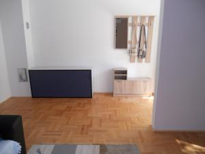 A television and/or entertainment center at Apartment Tarik