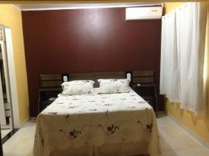 A bed or beds in a room at Casa da Mara