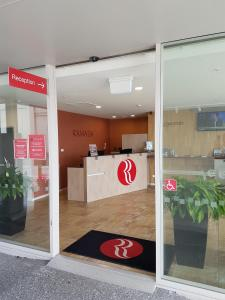 The lobby or reception area at Ramada Suites by Wyndham Christchurch City