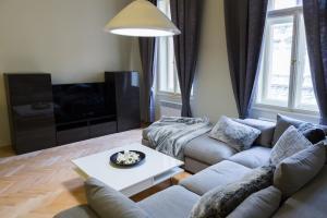Χώρος καθιστικού στο Prague Golden Age Apartment