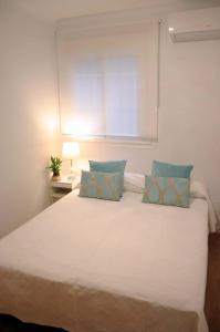 Ein Bett oder Betten in einem Zimmer der Unterkunft Reina Sofía Acogedor