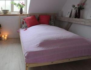 Ein Bett oder Betten in einem Zimmer der Unterkunft Landgut Jungbrunnen