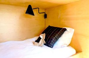 A bed or beds in a room at The Pavilion