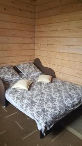 A bed or beds in a room at Guest House Suzdal-33