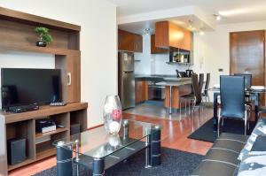 Una cocina o zona de cocina en Norus Apartments Providencia