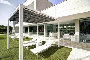A porch or other outdoor area at Beach & Golf Luxury Villa Alicante