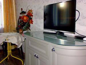 A television and/or entertainment centre at Elegant Apartment
