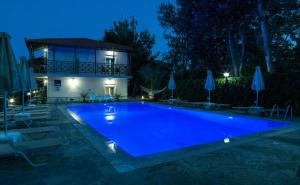 The swimming pool at or near Studio Nikos