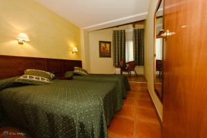 A bed or beds in a room at Els Meners