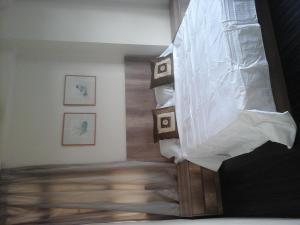 A bed or beds in a room at Kempas Apartment, Genting View Resort