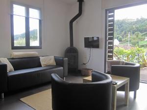 A área de bar ou lounge em Casa Das Furnas