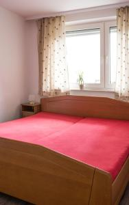 A bed or beds in a room at Apartment Ludwig-Feuerbach-Strasse