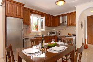 A kitchen or kitchenette at Dimitris Apartments
