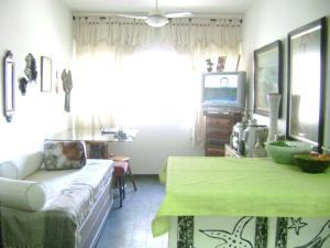 A seating area at Apartamento mobilhado na quadra da Praia - Jardim Camburi