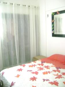 A bed or beds in a room at Apartamento mobilhado na quadra da Praia - Jardim Camburi