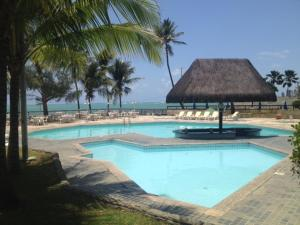 The swimming pool at or near Brandao Golden Beach Flat