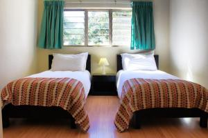 A bed or beds in a room at Victoria Apartments