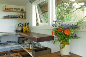 A kitchen or kitchenette at Haumoana Herb Cottage