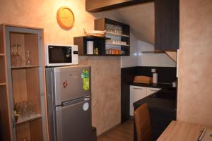 A kitchen or kitchenette at Apartment Borovnica