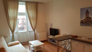 Ein Sitzbereich in der Unterkunft Hugo Apartment Prague