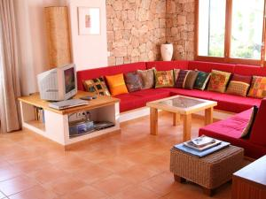 The lounge or bar area at Spacious Holiday Home in St Josep de sa Talaia with Pool