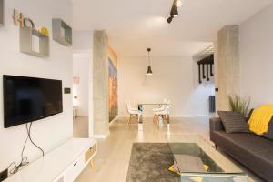 The lounge or bar area at Granada Home Centro