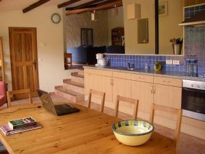 A kitchen or kitchenette at Calm Holiday Home with Swimming Pool in Carces France