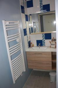 Salle de bains dans l'établissement Appartements Vacances Dinard