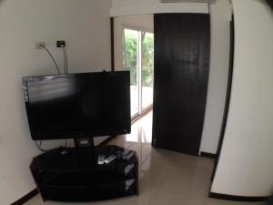 A television and/or entertainment center at Beach House Guanacaste