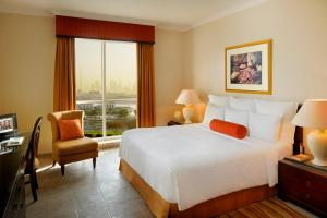 A bed or beds in a room at Marriott Executive Apartments Dubai Creek