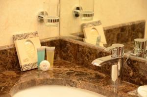 A bathroom at Abat Suites