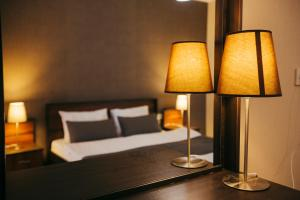 A bed or beds in a room at Aparthotel Holiday Lux Batumi