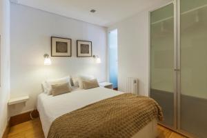 Łóżko lub łóżka w pokoju w obiekcie Go2oporto River