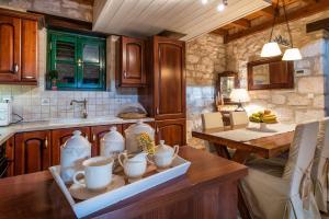 A kitchen or kitchenette at Anassa Villas