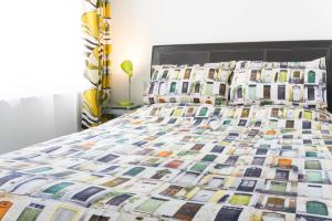 A bed or beds in a room at ArtHouse Boutique Apartment