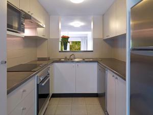 A kitchen or kitchenette at Medina Serviced Apartments North Ryde Sydney