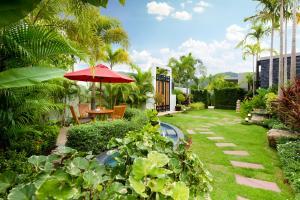 A garden outside Villa Nadya - 3 Bedroom Pool Villa