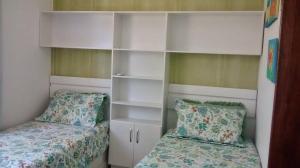 A bed or beds in a room at Apartamento Condomonio Antares
