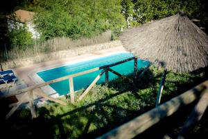 A view of the pool at Casa del Huerto or nearby
