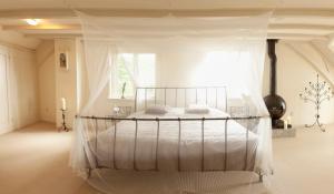 Een bed of bedden in een kamer bij Patricius House
