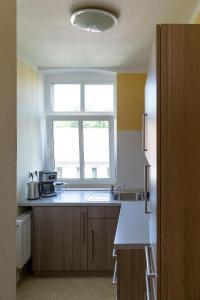 Küche/Küchenzeile in der Unterkunft Bebelstr. 67