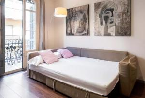 A bed or beds in a room at Tendency Plaza España