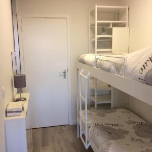 Een stapelbed of stapelbedden in een kamer bij StudioWestdiep