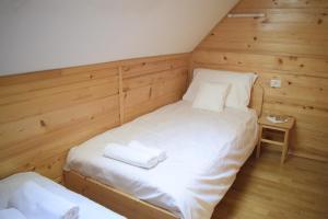 Postelja oz. postelje v sobi nastanitve Chalet Pokljuka