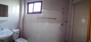 A bathroom at Majesty Residence