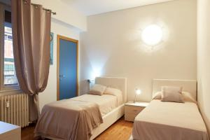 A bed or beds in a room at Maison de Amelie