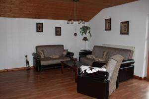 Ein Sitzbereich in der Unterkunft Ferienwohnung Landhausliebe